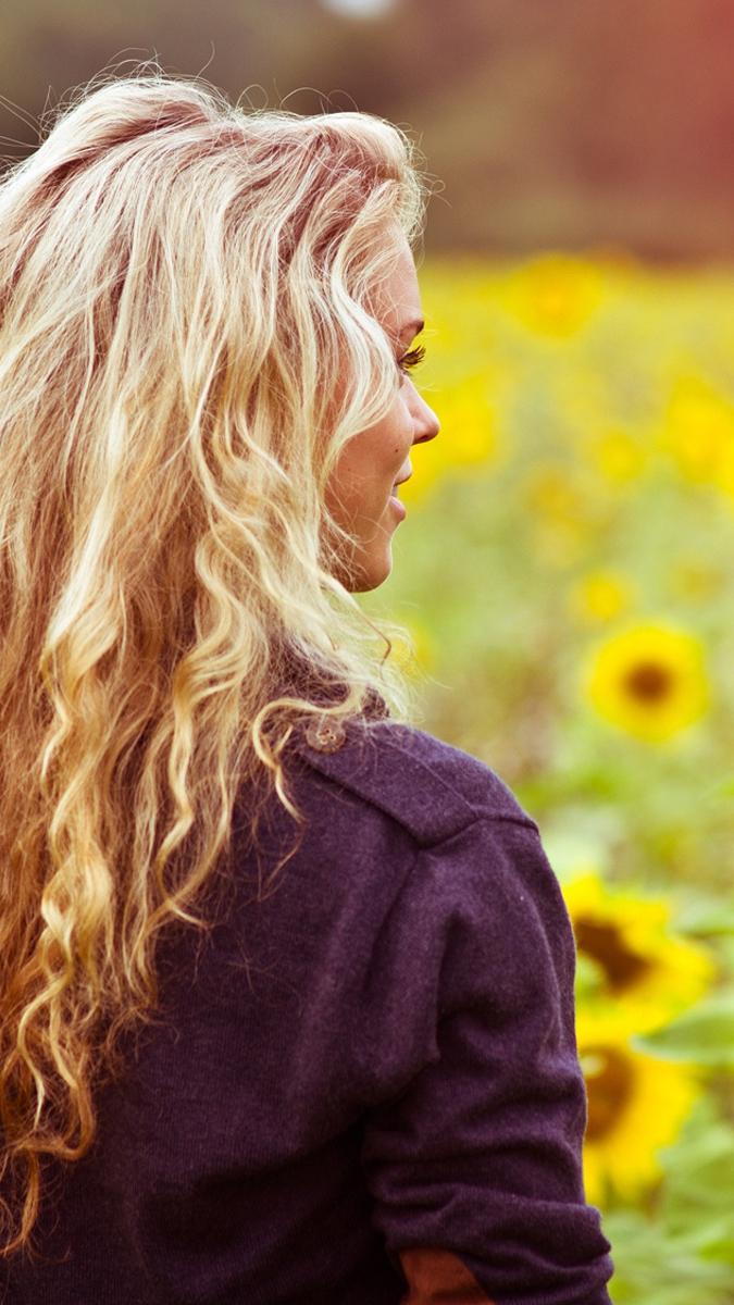 Girl around Sunflowers iPhone Wallpaper iphoneswallpapers com