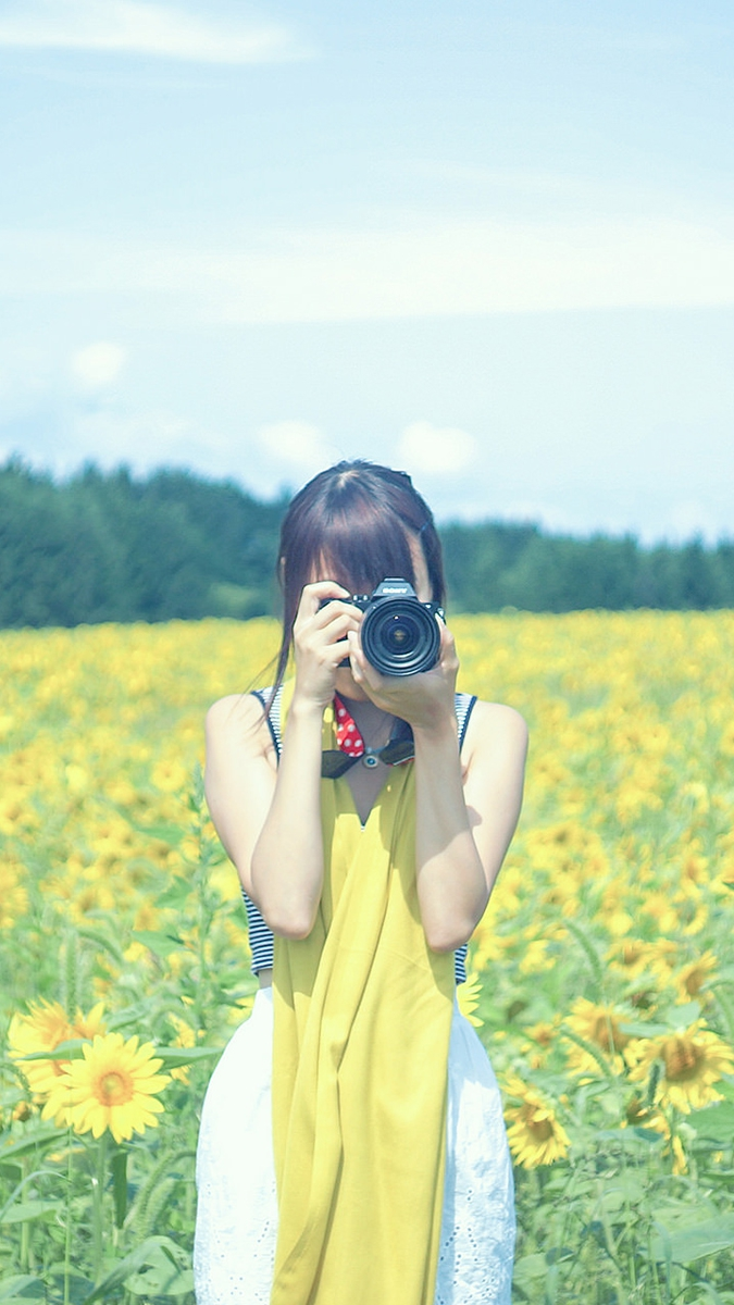 Girl taking picture in farmes iPhone Wallpaper iphoneswallpapers com