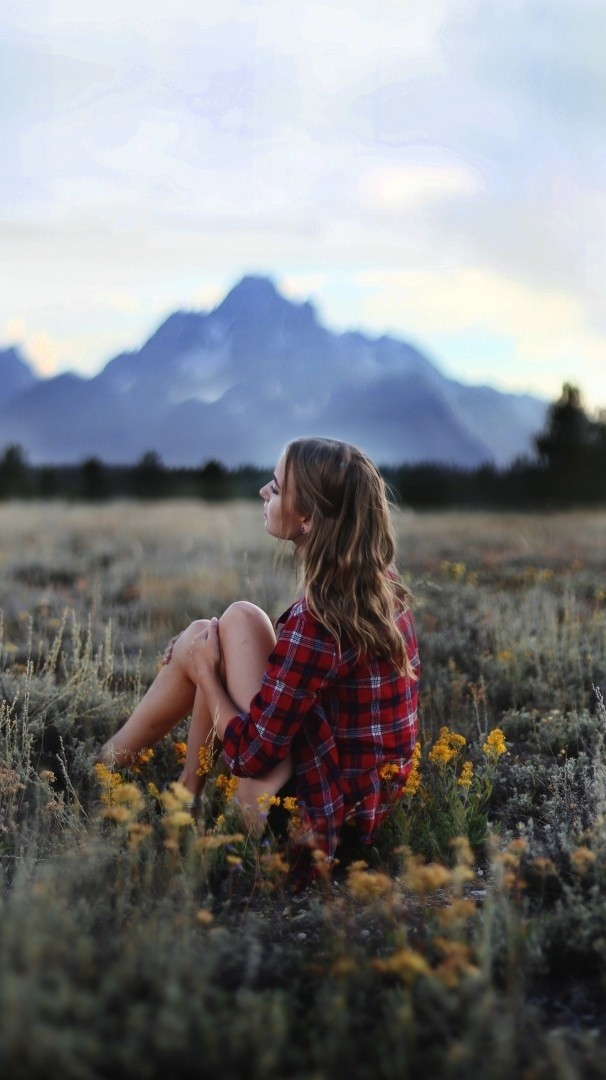 Girl Sitting In Nature Grass Flowers Mountains Iphone