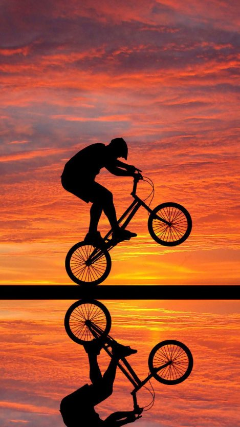 cyclist sunset clouds reflection iPhone Wallpaper iphoneswallpapers com
