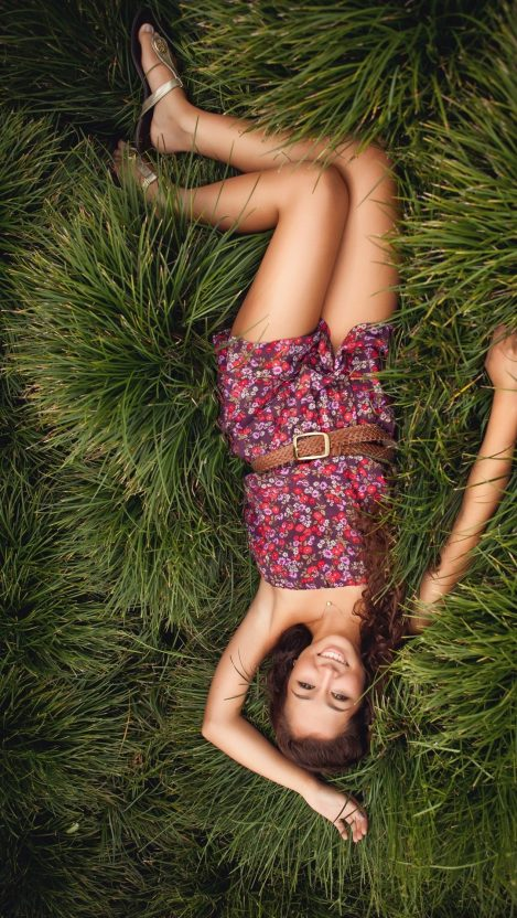 Girl Laying in Nature Smile iPhone Wallpaper iphoneswallpapers com