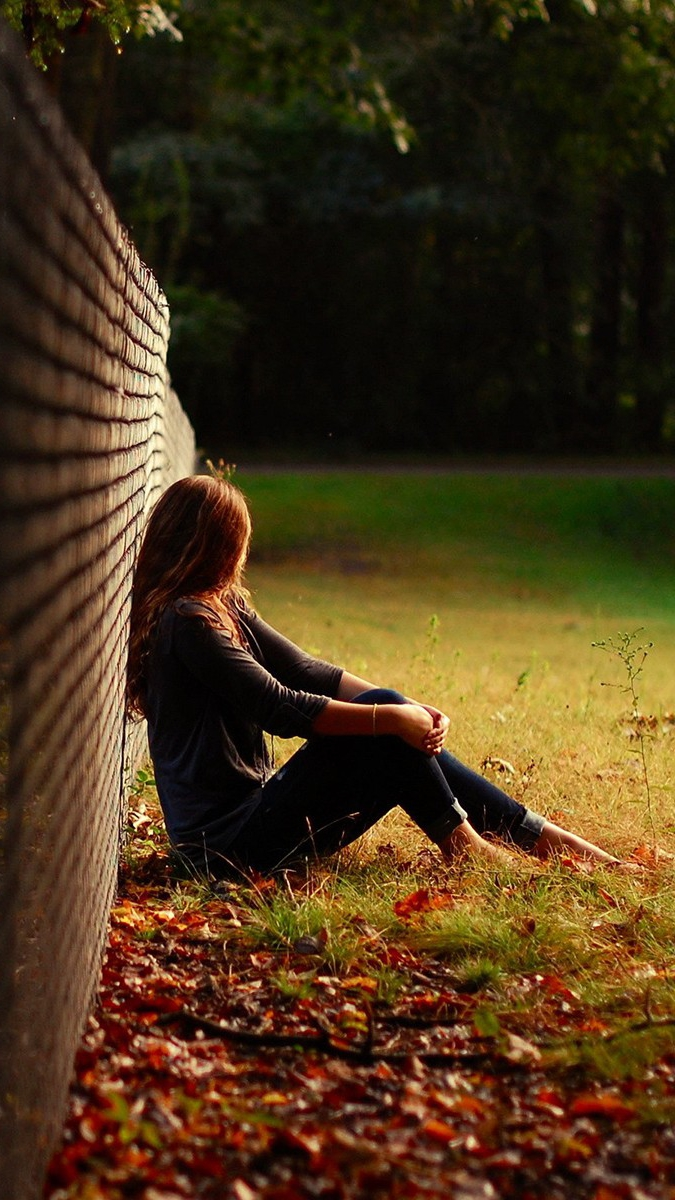 Girl Sitting in Nature Grass Wallpaper iPhone Wallpaper iphoneswallpapers com