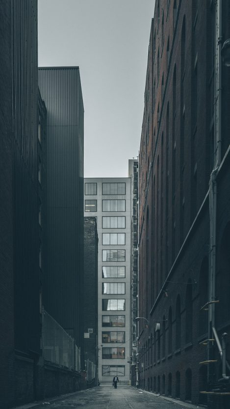 Man and Buildings iPhone Wallpaper iphoneswallpapers com