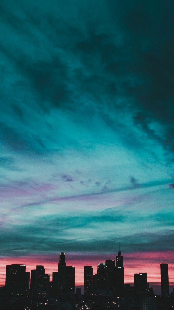 Sunset City Buildings Blue Clouds iPhone Wallpaper