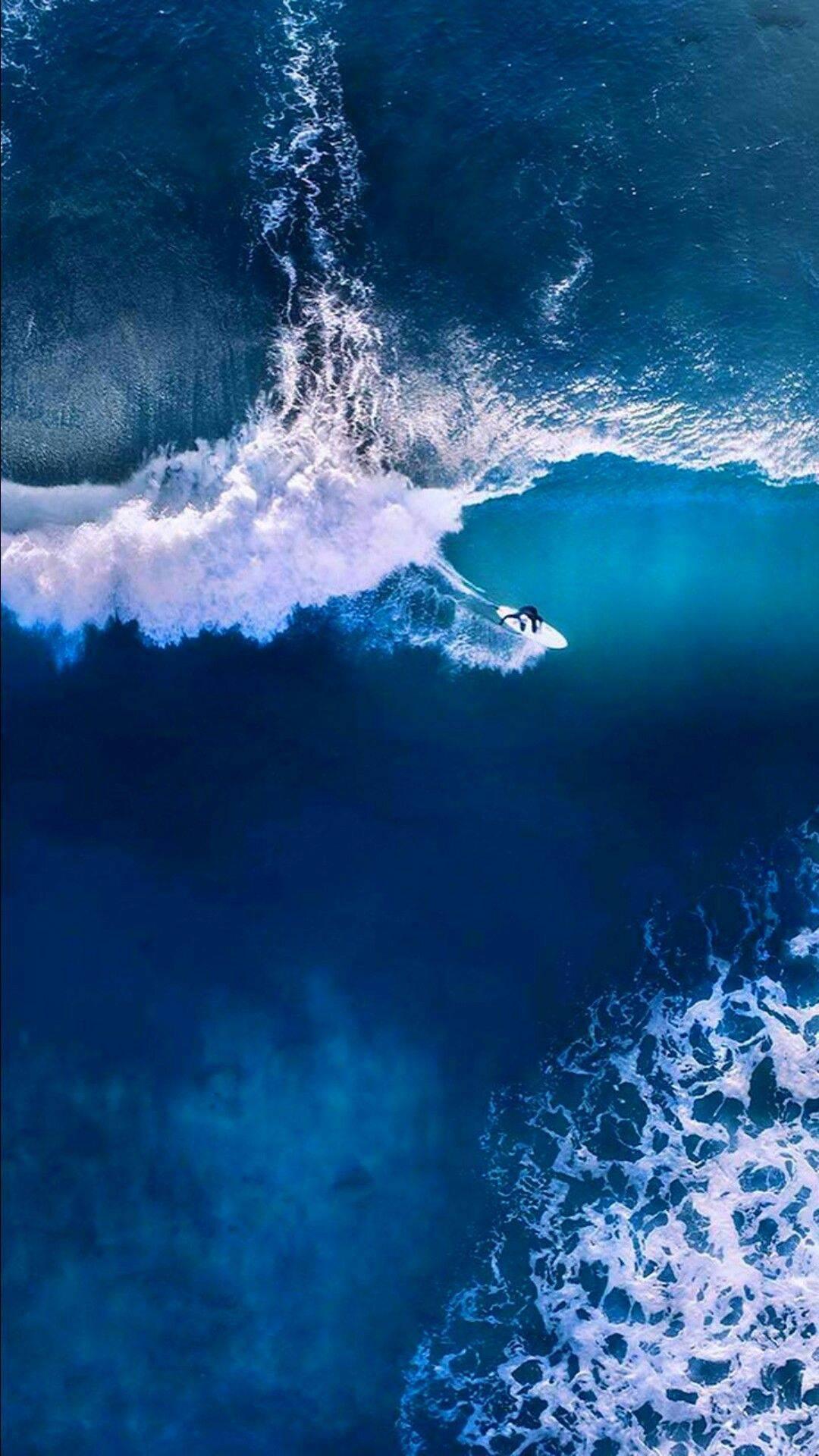 Surfing in Ocean iPhone Wallpaper