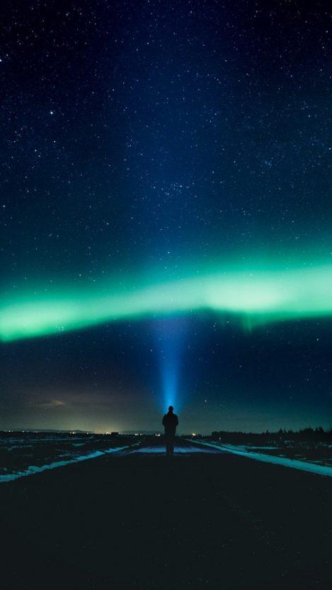 Man Watching Nothern Lights iPhone Wallpaper