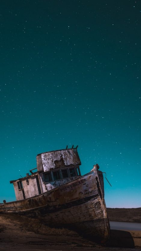 Rusted Ship in Night Sky View iPhone Wallpaper