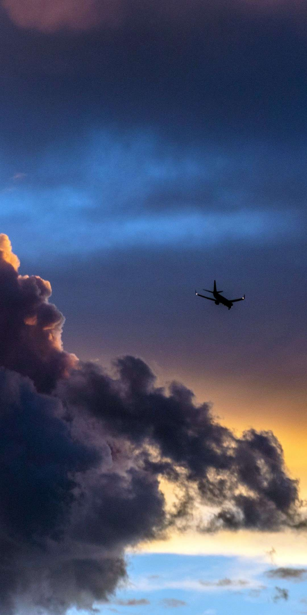 Plane in Clouds Sunset iPhone Wallpaper