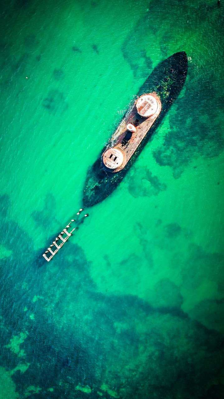 Rusted Ship Ocean Drone View iPhone Wallpaper