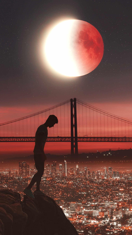 Man in City Eclipse Moon iPhone Wallpaper