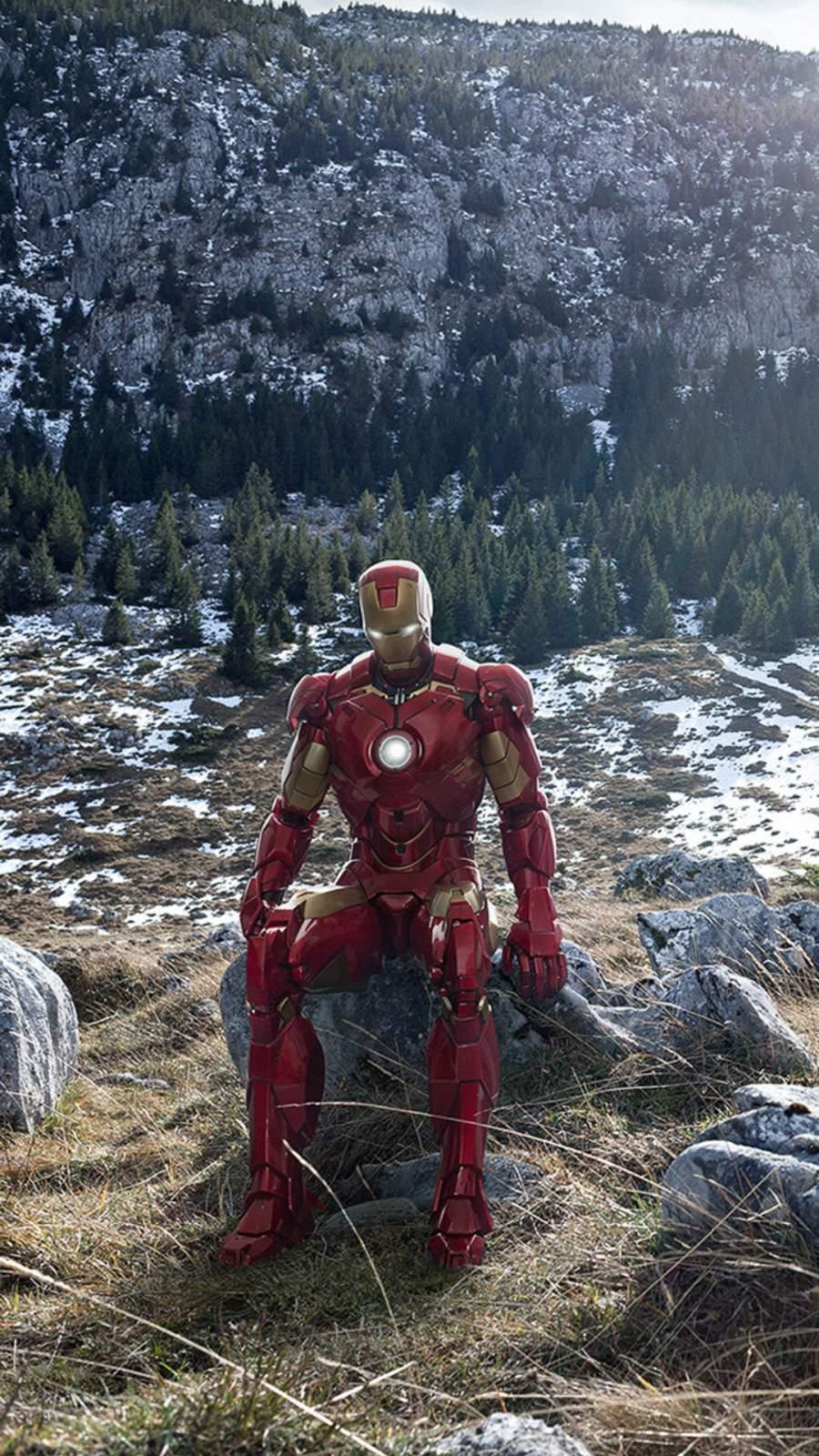 Iron Man Sitting on Stone Mountains iPhone Wallpaper