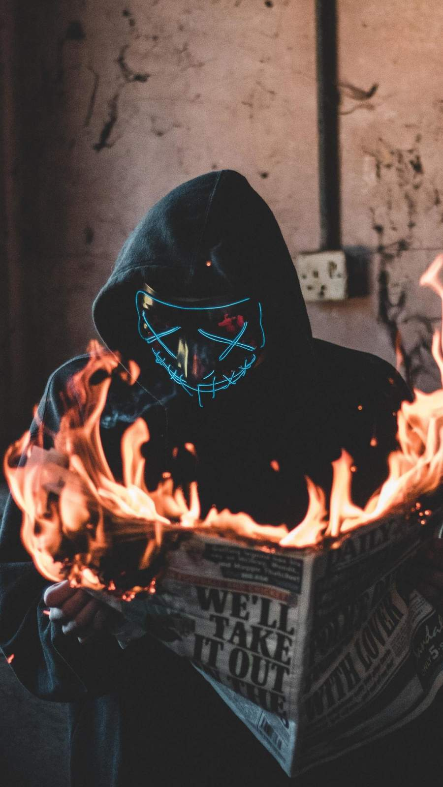 Hidden Mask Guy Burning Newspaper iPhone Wallpaper