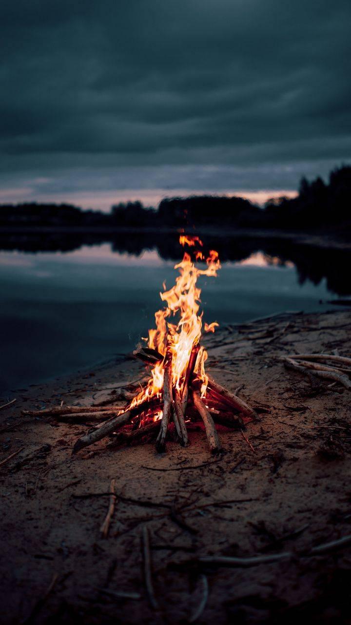 Camping Fire Near Lake iPhone Wallpaper