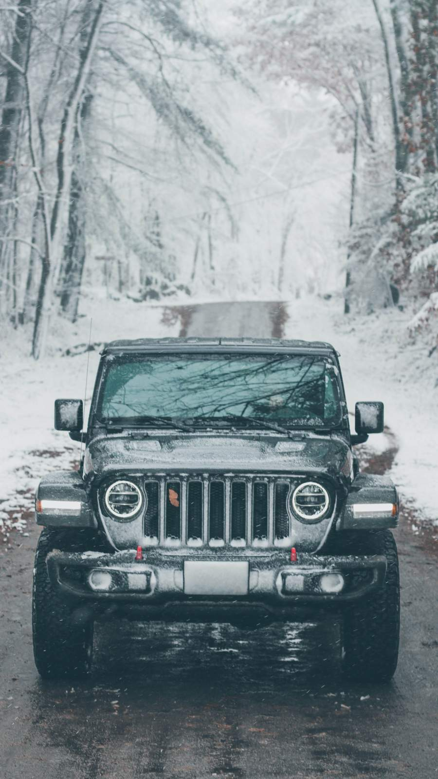 Jeep in Snow iPhone Wallpaper