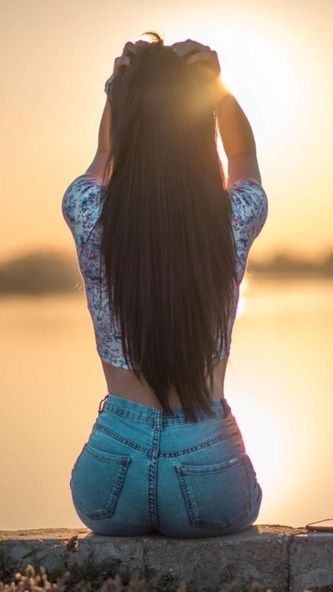 long hair girl sitting alone